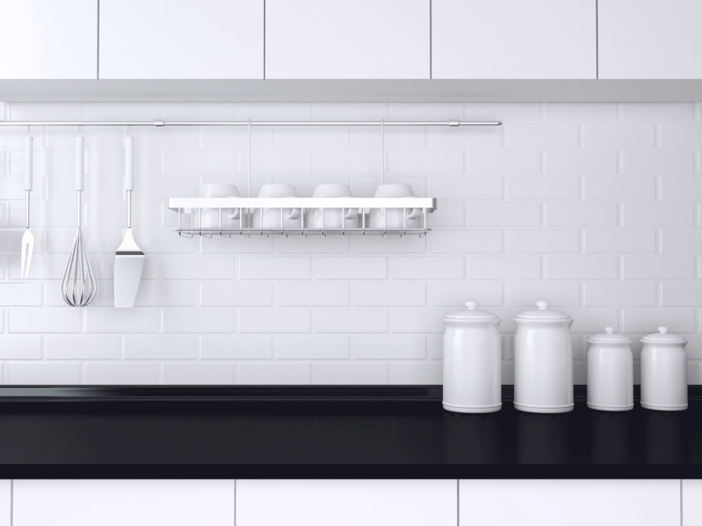 30528805 - utensils and kitchenware on the worktop. black and white kitchen design.